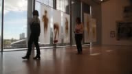 Low Angle Long Shot visitors walk through a gallery during the opening day of the Pérez Art Museum Miami on December 4 2013 in Miami Florida The...