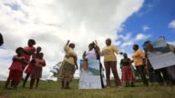 Low Angle Long Shot Xhosa women sing and dance as young men take part in a manhood ceremony in Qunu ahead of the funeral of Nelson Mandela on...