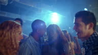 Low angle medium shot crane shot people dancing in nightclub / Panama