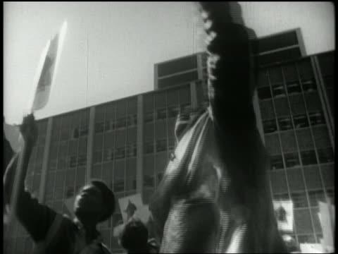 1969 low angle medium shot protesters shouting with signs at Free Huey Newton rally / San Francisco CA / AUDIO