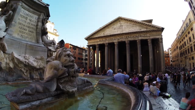 Low angle of small fountain and exterior of the Pantheon in Rome Italy
