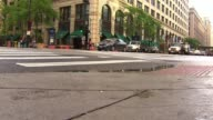Low Angle Shot Of Cars Driving On Street