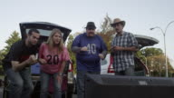 Low angle shot of friends tailgating and celebrating