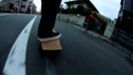 Low angle shot,skateboard cruising,Tokyo,Japan