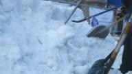 Low angle, shoveling snow