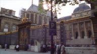 low angle side car point of view PAN gate in front of Palais de Justice with Sainte Chapelle in background / Paris, France