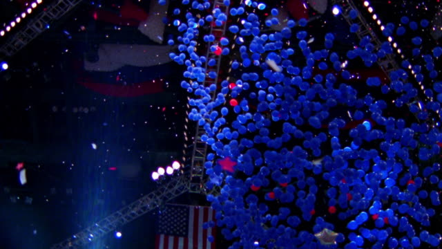 low angle tilt down PAN falling blue balloons at Democratic National Convention / Los Angeles, CA
