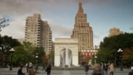 Low angle time lapse wide shot of fountain at Washington Square Park / New York City, New York, United States