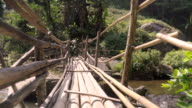 low angle view: bamboo made bridge
