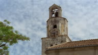 Low angle view of the clock tower of Chiesa di San Giovanni in Pontone / Salerno, Campania, Italy