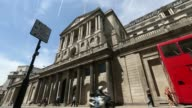 Low angle views an Union Jack flag flies on the roof of the Bank of England on a sunny summer day in London UK on Friday June 6 Traffic and...