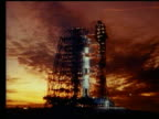 low angle wide shot of Apollo 16 rocket on launch pad at dawn
