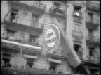 B/W 1960 low angle 'ZONE FRANCAISE' sign on barriace / tilt down to soldiers / Algeria / newsreel
