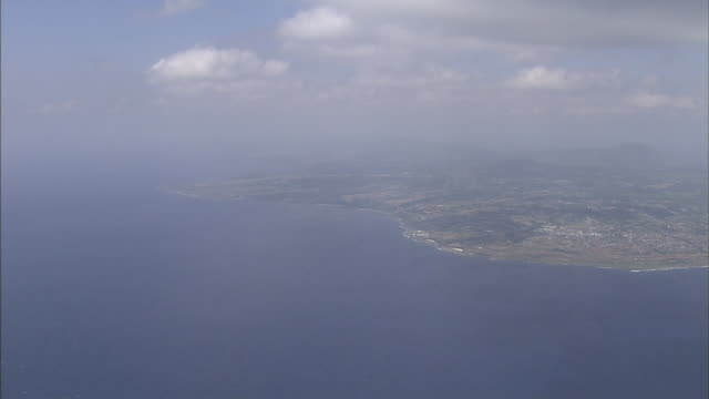 Low clouds drift above the East China Sea and Tokunoshima Island, Japan.