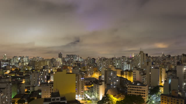 TL, WS Low clouds passing over Sao Paulo skyline and traffic at night / Sao Paulo, Brazil