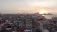 low level flying over Havana streets to reveal Malecon