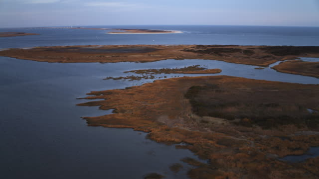 Low over water and marshy islands, crossing Little Egg Inlet, New Jersey. Shot in November 2011.