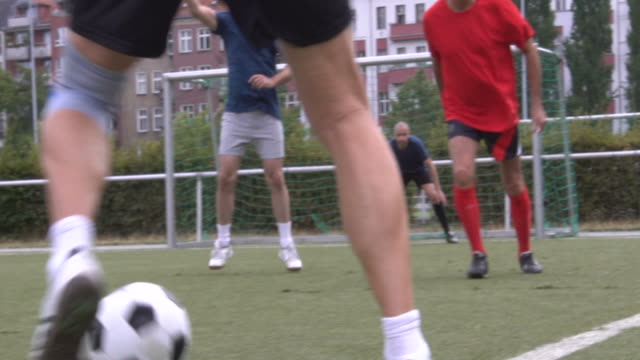 Low section of active males playing soccer