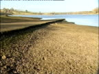 Low water level in Pitsford Reservoir at the start of a drought