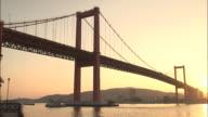 Low-angle shot of the red beam of Wakato Bridge, Japan
