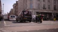Lower angle shot of traffic travelling across Regent Street, London.
