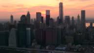 AERIAL SIDE POV Lower Manhattan skyline at sunset