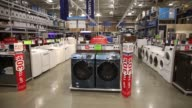 Lowe's washing machines signs and concrete is displayed inside a Lowe's Cos store in Burbank California US on Friday May 19 2017 Shot CU of Memorial...