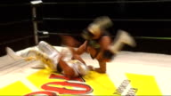 London Camden Roundhouse INT Unidentifed Mexican wrestlers grapple in ring Interview with unidentified man SOT People will be attracted by colour...