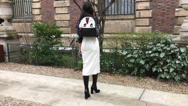 Lucina Tranchesi wears Louis Vuitton shoes Le Petit Jouet backpack Eloi skirt and Jacket as she arrives at the Nehara Show Street Style Paris Fashion...
