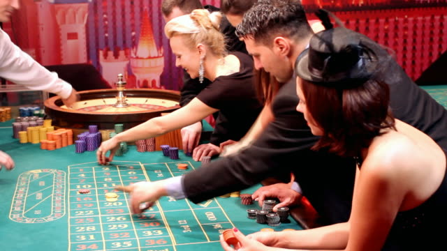Lucky attractive people having fun at casino.