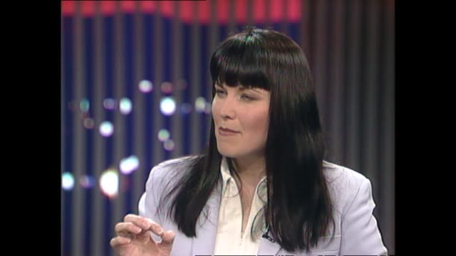 Lucy Lawless speaking about enjoying acting during school adaptation of The Prodigal Son during interview with host Susan Wood in 1997