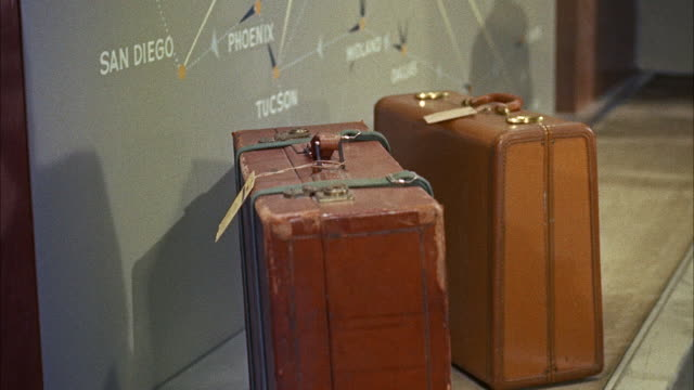 MS TU Luggage being weighed in placing on conveyor belt / Washington D.C., United States