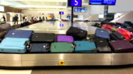 Luggage on baggage carousel after arrived airport