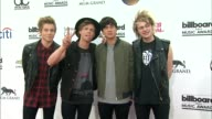 Luke Hemmings Ashton Irwin Calum Hood and Michael Clifford of 5 Seconds of Summer at the 2014 Billboard Music Awards Arrivals at the MGM Grand Garden...
