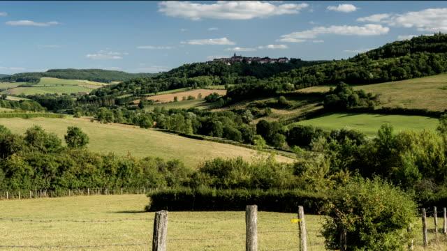 Lush pastures of Pays de l'Auxois and village of Flavigny-sur-Ozerain