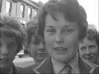 Luton school girls protest over badge ENGLAND Bedfordshire Luton EXT Close shot badge on girl's blazer with bar across it Janet Richards Banners held...