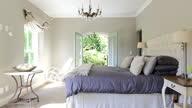 Luxury bedroom opening to garden