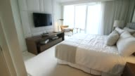 Luxury hotel in Miami Florida US on December 7 Pan of living room and kitchen area Wide shots of bathroom Walking wide shot into bedroom Pan of...
