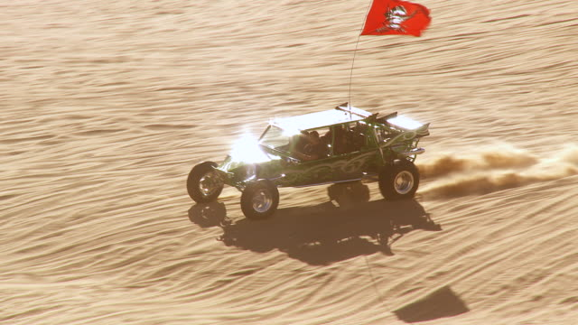 WS TS ZO Luxury sandrail racing across sand dunes / Glamis, California, USA
