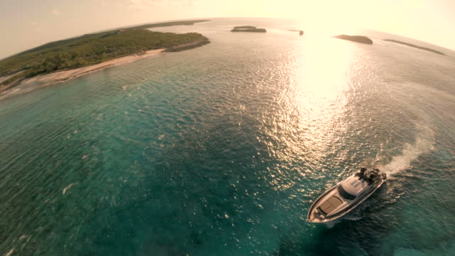 Luxury Yacht cruises blue waters of Bahamas from Drone