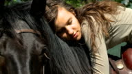 HD SLOW-MOTION: Lying on a horse