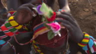 Maasai Ceremony - Young warriors preparing for ceremony, WITH AUDIO