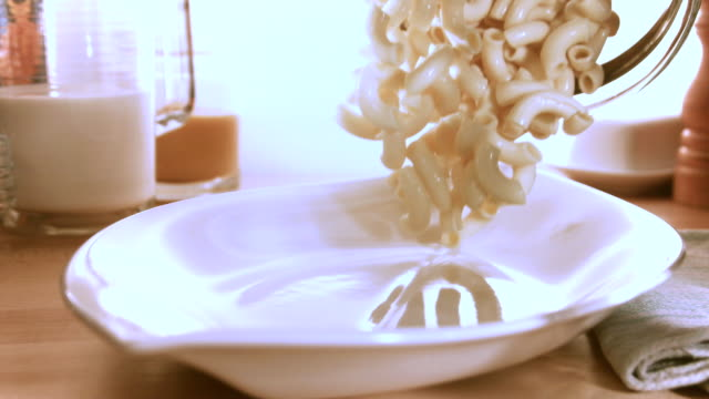 MS SLO MO Macaroni pasta landing in plate / Los Angeles, CA, United States