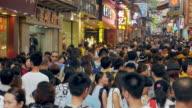 Macau pedestrian shopping walkway with crowds of people