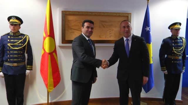 Macedonian Prime Minister Zoran Zaev and Kosovan Prime Minister Ramush Haradinaj inspect honor guards during the official welcoming ceremony in...