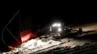 Machine for leveling the ski slopes works at night.