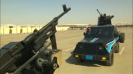 A machine gun swivels atop an armored truck on a military base in Saudi Arabia.
