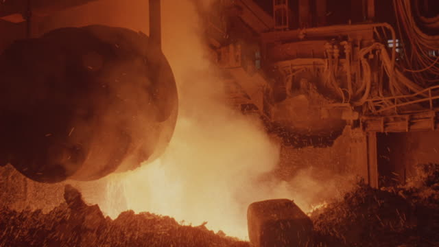 A machine pours steel in a foundry.