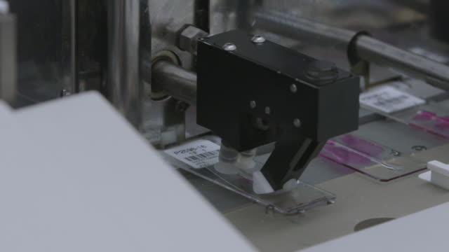 CU of machine preparing slide for cell analysis