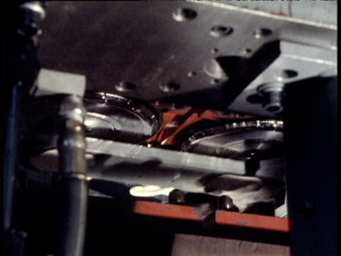 Machine pressing and cutting vinyl records 1980s